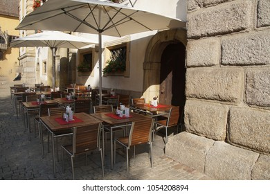 REGENURG , GERMANY - SEP 9, 2016 - Table and chairs outside restaurant in  Regensburg, Germany