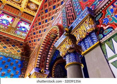 REGGELLO, ITALY - SEP 20: Detail of polychrome stucco decorations, arch and columns in Sammezzano Castle on SEP 20, 2015 in Reggello, Tuscany, Italy.