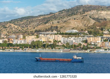 Reggio Calabria, Italy - October 30, 2017: General Cargo Ship NS Koralle in the Messina Strait at Reggio Calabria, in Italy. Reggio di Calabria is a city in Calabria on the toe of Italy.