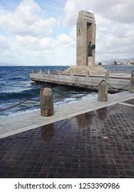 "Reggio Calabria, Italy/Italy - December 2018  View of the street near sea of Reggio Calabria inside of the ""ARENA ITALO FALCOMATA'"". Sculpture at Athena Promachos of the Bonfiglio sculptor."