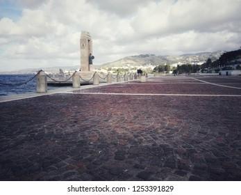"Reggio Calabria, Italy/Italy - December 2018  View of the street near sea of Reggio Calabria inside of the ""ARENA ITALO FALCOMATA'"". Sculpture at Athena Promachos of the Bonfiglio sculptor. Old ROAD"