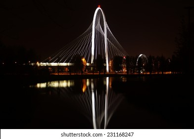 REGGIO EMILIA , ITALY -1 APRIL 2014: near the highway bridge designed by Calatrava photographed at night reflected in the lake adjacent