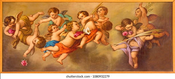 REGGIO EMILIA, ITALY - APRIL 12, 2018: The painting of angels in church Chiesa dei Cappuchini by Padre Angelico da Villarotta (1900 - 1987).