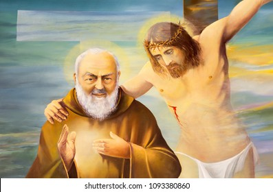 REGGIO EMILIA, ITALY - APRIL 12, 2018: The modern painting of Pater Pio with the Jesus on the corss in church Chiesa dei Cappuchini by Erico Verona 2001.