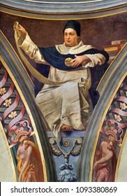 REGGIO EMILIA, ITALY - APRIL 12, 2018: The Fresco of Saint Thomas of Aquinas in cupola of church Basilica di San Prospero by  C. Manicardi, G. Ferrari and A. Lugli (1884-1885).