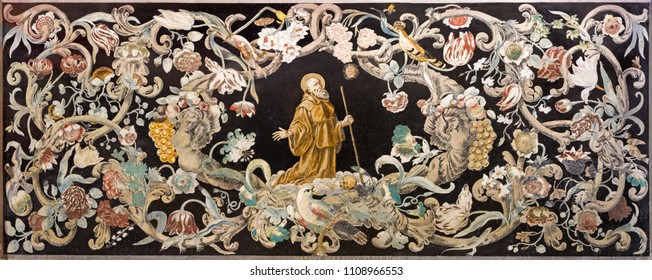 REGGIO EMILIA, ITALY - APRIL 12, 2018: The stone mosaic (Pietra Dura) with the holy  monk at the prayer in church Chiesa di Santo Stefano by Marcus Mazelius (1700).