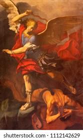 REGGIO EMILIA, ITALY - APRIL 12, 2018: The painting of Michael Archangel in Duomo church by Orazio Talami (1624 – 1708).