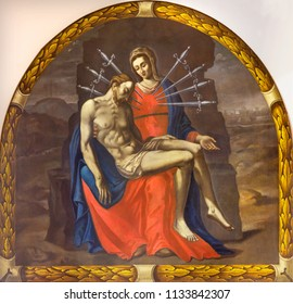 REGGIO EMILIA, ITALY - APRIL 12, 2018: The painting of Pieta (Madonna of Seven Sorrows) in church Chiesa die Cappuchini by unknown artist of 17. cent.