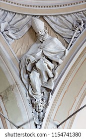 REGGIO EMILIA, ITALY - APRIL 12, 2018: The relief of St. Ambrose doctor of the West Catholic Church in church Chiesa di San Agostino by Paolo Emilio Besenzi  (1608 – 1656).