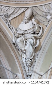 REGGIO EMILIA, ITALY - APRIL 12, 2018: The relief of St. Augustine the doctor of the West Catholic Church in church Chiesa di San Agostino by Paolo Emilio Besenzi  (1608 – 1656).