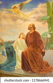 REGGIO EMILIA, ITALY - APRIL 12, 2018: The modern painting of Joseph with the Jesus in Exile in Egypt in church Chiesa dei Cappuchini by Leonardo Cremonini (1925 - 2010).