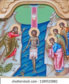 REGGIO EMILIA, ITALY - APRIL 12, 2018: The icon of Baptism of Jesus on the iconostas in church Chiesa di San Giorgio in Reggio Emilia from 20 cent.