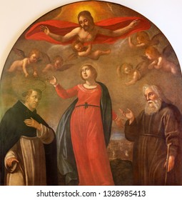 REGGIO EMILIA, ITALY - APRIL 12, 2018: The painting of Virgin Mary, Jesus and St. Peter the Martyr and Saint Vincent de Paul  in church Chiesa dei Cappuchini by unknown artis of 17. cent.