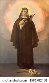 REGGIO EMILIA, ITALY - APRIL 12, 2018: The painting of Teresa of Ávila (Theresa of Jesus) in church Chiesa dei Cappuchini rom 20. cent.