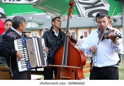 REGIETOW, POLAND - JULY 11, 2015: Gipsy music group playing live music in Regietow. Poland