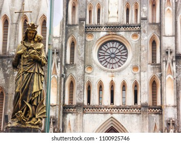 Regina Pacis (Queen of Peace) Statue in front of St. Joseph's Cathedral, Hanoi, Vietnam. St. Joseph's Cathedral is a Neogothic style church that serves as the cathedral of the Roman Catholic