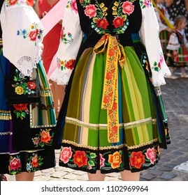 Regional, folklore costumes, colorful handmade skirts with stripes and symbols embroidered. During Corpus Christi parade.