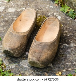 Regional tradition and culture, handmade concept. Closeup of wooden dutch shoes, traditional clogs footwear