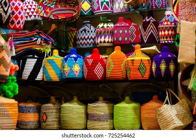 Regional, traditional hand made from wool goods on medina souk: bottle covers, containers and boxes. Horizontal close up crop