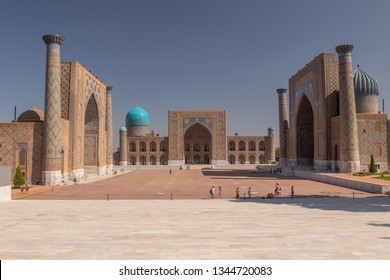 Registan square with ancient madrasahs. The Uzbekistan city of Samarkand. Sunny summer day in an ancient city in Central Asia. Minarets and madrasahs on the square in Samarkand.