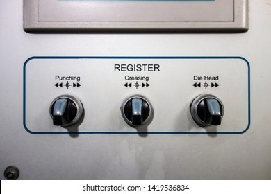A Register Adjust Button on the Metal Surface