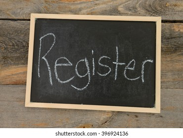 Register written in chalk on a chalkboard on a rustic background