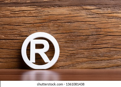 Registered Trademark Sign In Front Of Wooden Wall