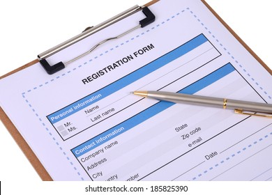 Registration form on clipboard on white background.