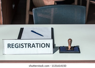 Registration table with Inking Rubber Stamp.