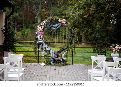 registration of wedding, exit registration, white chairs, arch of flowers. round wedding arch.