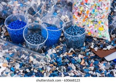regrind of milled plastic goods with color samples for recycling industry and plastic bag with virgin material