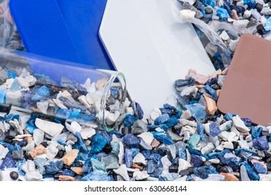 regrind of milled plastic goods with color samples for recycling industry out of plastic bag with test glass