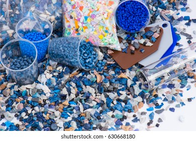 regrind of milled plastic goods with color samples for recycling industry and plastic bag with virgin resin