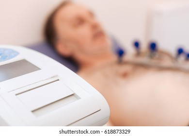 Regular mature man experiencing echocardiogram