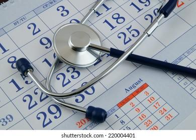 Regular medical examination concept, stethoscope on calendar
