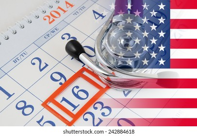 Regular medical examination concept, stethoscope on calendar with usa flag