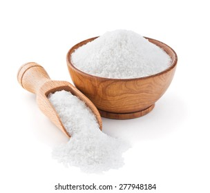 Regular table salt in a wooden bowl isolated on white background