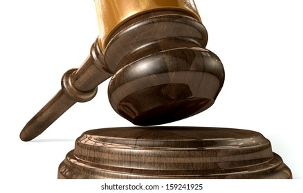 A regular wooden auctioneers hammer or judges gavel with copper trim on an isolated background