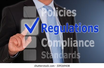 Regulations - Businessman with checkbox