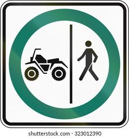 Regulatory road sign in Quebec, Canada - Pedestrian and ATV lane.