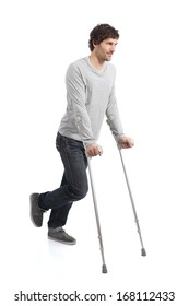 Rehabilitation of an adult man walking with crutches isolated on a white background