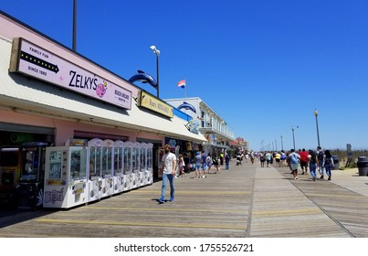 Rehoboth Beach, Delaware, U.S.A - June 13, 2020 - The view of the boardwalk with visitors wearing mask and practicing social distancing