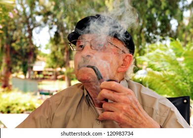 REHOVOT - JULY 17: A man smokes medical Cannabis in nursing home Hadarim on July 17, 2011 in Rehovot, Israel.Medical Marijuana use has been permitted since the 90s for patients pain-related illnesses