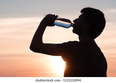 Rehydrate your body. male drinking a bottle of water.