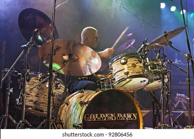 """REICHENBACH, GERMANY - JANUARY 14: Member """"Sascha Heil"""" of the rock group """"Golden Dawn"""" performs in concert Reichenbach on January 14, 2012 in Wuerttemberg, Germany"""