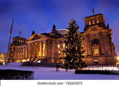 reichsatg building in winter with christmas tree and snow in berlin