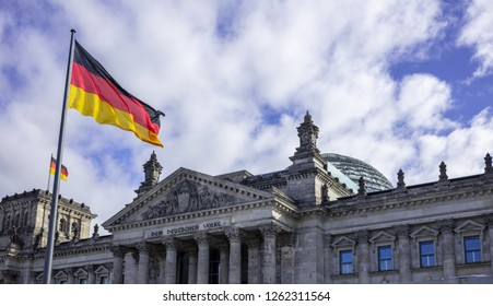 Reichstag building in Berlin, Germany. Under view, part of stately house, clouds travel on the sky background.