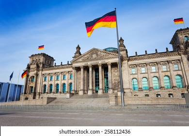 Reichstag facade view with German flags in Berlin, Germany
