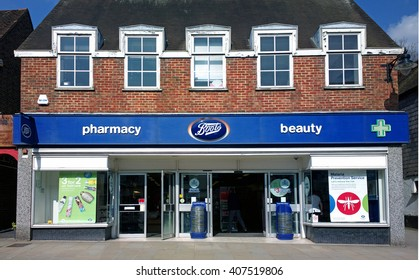 REIGATE, UNITED KINGDOM - MARCH 22, 2016: Front exterior of a Branch of British pharmacy chain Boots, which is now owned by parent company Walgreens Boots Alliance.