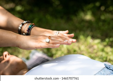 Reiki healers hands over a female's heart